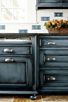 Navy Kitchen Cabinet Paint Color The perimeter cabinetry is cherrywood painted in Benjamin Moore Mozart Blue with black glaze. Navy Kitchen Cabinets, Kitchen Cabinet Colors, Painting Kitchen Cabinets, Diy Cabinets, Kitchen Paint, Bathroom Cabinets, Rustic Cabinets, Kitchen Colors, Farmhouse Cabinets