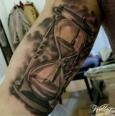 Grey Ink Realistic Hourglass Tattoo On Bicep