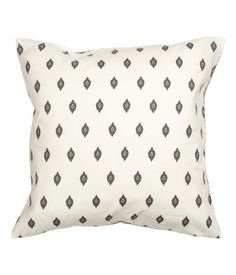 Cushion cover in woven cotton fabric with different printed patterns at front and back. Concealed zip at lower edge.