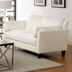 "Pierre White Loveseat - CM6717-LV $230  Description :  Although simple at first glance, this seating group has special features found in the details. Double stitching runs across the black, white, or mahogany red leatherette, while the inside armrests are cushioned for maximum comfort.  Features :  Contemporary Style Cushioned Inside Armrests Double Stitching Leatherette Available in 3 Colors Dimensions : Loveseat : 57""L X 33 1/4""W X 33 1/4""H"