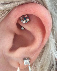 """Jennifer loved her year old Rook piercing and she wanted to really show it off.  She went all out and we placed a White Gold and London Blue Topaz """"Angela"""" from @bvla on there!  Wonderful taste Jennifer! Wonderful!  _______________________________________________________ #btwbodyarts #safepiercing #bvla #appmember #rook #rookpiercing #legitpiercings"""