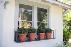 Curb Appeal and Landscaping Ideas from Fixer Upper to be inspired by. Flower containers or urns, window boxes, and landscaping ideas from Fixer Upper. Fixer Upper, Metal Window Boxes, Window Planters, Balcony Window, Metal Planters, Planter Boxes, Flower Window, Patio Interior, Interior Door