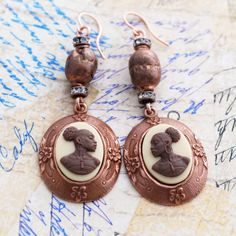 African prayer beads on cameo earrings for Black History Month, by Renee Hong of JewelryFineAndDandy on Etsy. Made with B'sue's lovely rosy copper mounts.