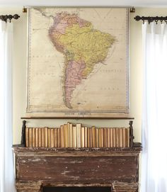 The distressed mantel in this Washington home was discovered on eBay, as was the old map that hangs above.   - CountryLiving.com