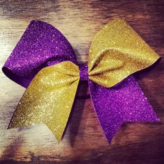 Buy gold and purple glitter cheer bow by bragaboutitcheerbows. Explore more products on http://bragaboutitcheerbows.etsy.com