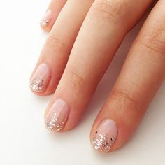 11 Easy-to-DIY Nail Art Designs: Take the edge of your favorite neon polish up a few notches with this easy-to-DIY V-shaped manicure idea.  : Try this minimalist approach to sparkling nail art for a fancy night out.
