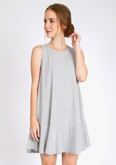 Grey and white striped swing dress with ruffle hem and round neckline. Unlined and opaque.