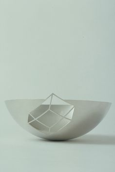 'Negative Bowl' by Ane Christensen. 2005. 'Negative space' optical illusion and the idea of cutting a form out of a surface.Sterling silver.