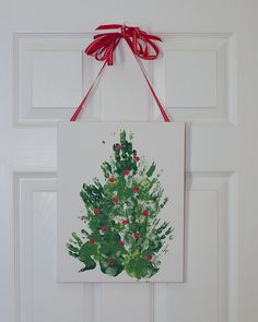 Handprint Christmas tree on canvas toddler craft. A keepsake for decades of future holidays