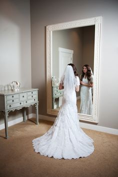 beautiful bride in a lace wedding dress getting ready on the morning of her wedding