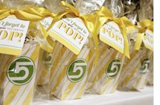 """Event designer Loralee Lewis went with a playful """"Make It Pop"""" theme for a client who wanted to energize guests. Lewis used a refreshing lemon and lime color scheme and themed food and beverage options, e.g. popcorn cake pops and Jello pop shots/ But the biggest hit at the event was the balloon pop activity: Using oversized pushpins, guests popped balloons to reveal written descriptions of their prizes."""