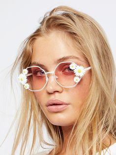 Ditsy Daisy Sunglasses | Inspired by decades past, these wire frame sunnies feature super cute daisy accents.    * Octogen shape   * Eye pads   * Colored lenses    WARNING: This product contains a chemical known to the State of California to cause cancer and birth defects or other reproductive harm.