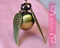 Harry Potter Golden Snitch Watch Necklace, with Golden double side wings -- My amazing boyfriend got this for me :)