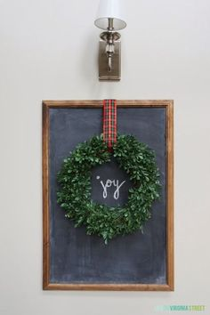 Neat way to incorporate a wreath and simplistic chalkboard art! Christmas Tour of Homes - DIY Christmas chalkboard art. Noel Christmas, Merry Little Christmas, Christmas Projects, Winter Christmas, Xmas, Simple Christmas, Cheap Christmas, Christmas Chalkboard Art, Diy Décoration
