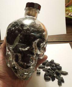 Glass skull filled with tektites - www.galactic-stone.com - #meteorites #tektites #skull