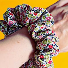 Scrunchies are BACK ! Make your own with left over fabric and a hair elastic by following these simple steps.