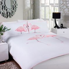 bed spread - Nothing will give your bedroom a whimsical feel quite like this pink flamingo duvet set. The duvet cover and pillowcases are highly embroidered and the contrasting piping finishes the set off perfectly.
