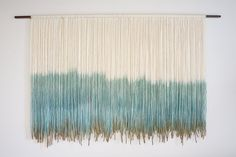 Tulum woven wall hanging dip dyed tapestry fiber by TheBohoLoft First the wooden dowel was sanded smooth, stained and sealed. Next, each piece of cream colored yarn was individually hand cut and strung on the dowel, then carefully dip-dyed multiple times to create a one-of-a-kind tapestry.