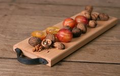 hand made wooden chopping board with wrought iron handles - by Made by the Forge