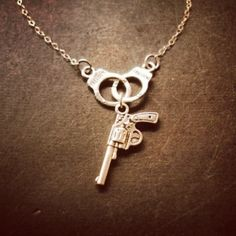Love this! To symbolize how Nando and I met! - Handcuff & Gun necklace from CRAFTED on Storenvy