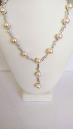 Enjoy this beautiful Pearl Necklace with Diamonds in 14K White Gold. The necklace features, 8+mm white pearls, 0.65 ct diamonds, and is in 14K white gold weighing 31.44 grams. The item comes in an elegant gift box and is guaranteed to be authentic. It's elegance and class will surely be the perfect accessory for a wonderful night out ! $875
