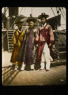 Three Korean gentlemen posed on deck of ship