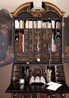 We are in love with this stunning Chinese-inspired secretary, which serves as a writing desk in the master bedroom. - Traditional Home® Photo: John Ellis Design: Carmen Lopez