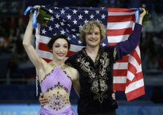 DAY 11:  Gold medalists Meryl Davis and Charlie White of the United States during the flower ceremony for Figure Skating Ice Dance