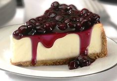 """This is a dense cheesecake that is very smooth and melts in your mouth. The white chocolate brandy sauce tops it off. I just nap it over the center of the slice of cheesecake on Cheesecake Day, No Bake Blueberry Cheesecake, Cheesecake Recipes, Dessert Recipes, Classic Cheesecake, Protein Cheesecake, Blueberry Cake, Yummy Treats, Delicious Desserts"