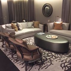Gorgeous TV area with curved sofa, day bed and armchairs #luxury #interiors #interiordesign #livingroom #lounge #SophiePatersonInteriors
