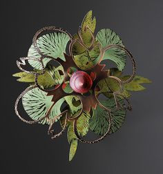 linda threadgill: rosette series made from metal. Brooch made from metal