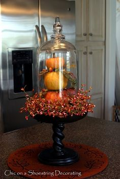 I have a pedestal nearly identical to this and the orange wreath.just need the glass dome for the top. Chic on a shoestring decorating Fall Home Decor, Autumn Home, Autumn Decorating, Decorating Pumpkins, Decorating Ideas, Konmari, Fall Table, Thanksgiving Decorations, Fall Decorations