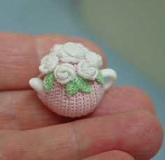 crocheted miniature tea cosy, cute but picture only - no pattern