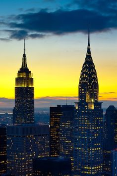 Beautiful sunset view of the New York skyscrapers highlighting the peaks of the Empire State and Chrysler Building!