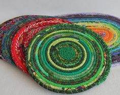 More coiled mats  (fabric-wrapped clothesline)
