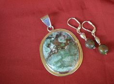 Beautiful natural turquoise pendant in a sterling silver bezel with matching leverback earrings!