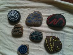 painted story stones - like the addition of some abstract designs, open to kids' interpretation