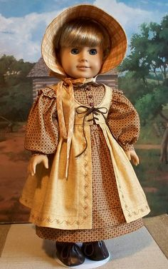 Looks like it should be worn by the Ingalls sisters.  The split pinafore is an interesting detail--as are the ruffles on the dropped shoulders.  Keepers Dolly Duds.