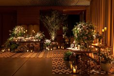 Composition in different wedding dessert tables with flower arrangements and candles