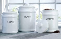 This beautiful set of ceramic kitchen canisters is hard to resist! Especially with our favorite glossy ceramic paired with this oh so popular font! They are not only fitting for the farmhouse fanatic but the vintage enthusiast as well! Food Canisters, Kitchen Canister Sets, Coffee Canister, Bakers Rack, Popular Font, Ceramics, Mugs, Tableware, Farmhouse