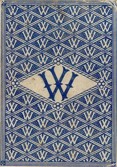 "Old playing card? ""W"" diagonally repeating pattern."