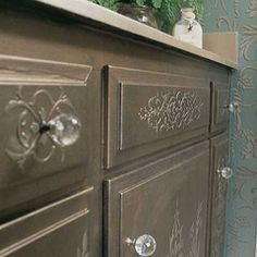 Our Micah Classic Panel & Furniture Stencil is a classic panel stencil design that is offered in two sizes. The furniture stencil size is featured here in the cabinet photos. Use the larger size repea