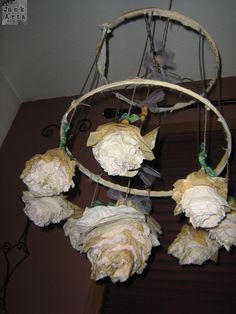 Fun Chandelier made with lamp shade base and coffee filter flowers by JunkArta https://www.facebook.com/MyJunkArta