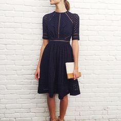 East Hampton: Mia at our East Hampton store wears Ryker Broidery Day Dress in Navy with Beach Clutch