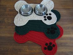 Crocheted Dog Bone Floor Placemat with Paw Print; Large by DACcrochet on Etsy https://www.etsy.com/listing/231788375/crocheted-dog-bone-floor-placemat-with