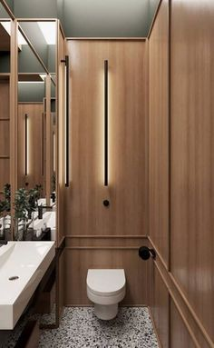 Powder room with wooden paneling