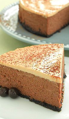 Decadent Mocha Cheesecake uses cocoa powder, chocolate-covered espresso beans, low-fat cream cheese and sour cream to give this cake a bakery flourish for Valentine's Day. #recipes #desserts