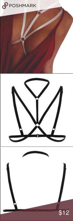 White Caged Body Bra Very sexy strappy bra. Has adjustable strap and back bra buckle closure. Intimates & Sleepwear Bras