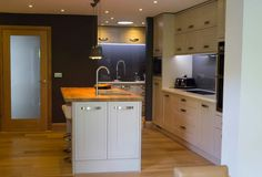 This gorgeous shaker style kitchen is our Tewkesbury Stone range and features a solid oak breakfast bar. Contact your builder or local Howdens depot to find out more.