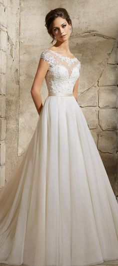 The versatility of the bateau neckline is best illustrated with this lacy number. It's feminine, a little rustic, a little princess-y, but still maintains a level of sophistication which runs through all of these wedding gowns.                                                                                                                                                      More